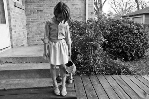 black and white photo of child pouting by kelly christine