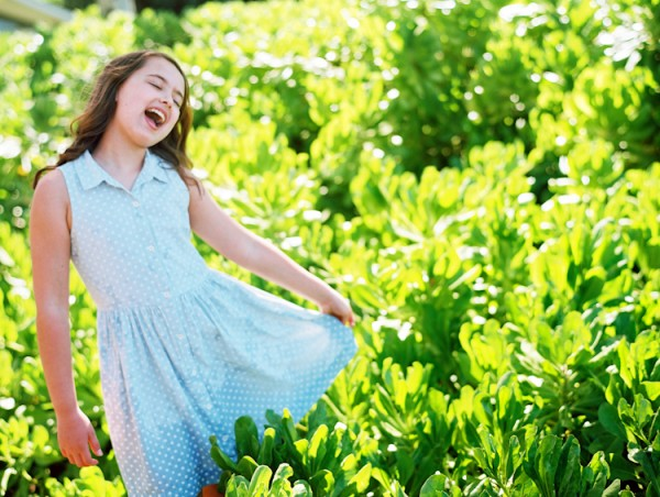 child dancing in field photo by Wendy Laurel