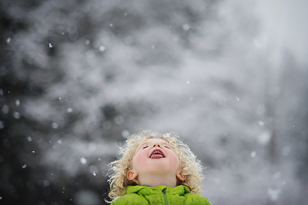 child licking snowflakes photo by robin bonner
