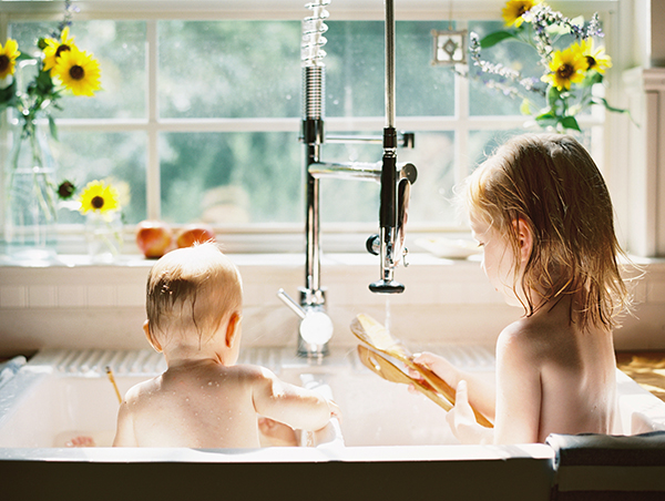 children bathing in sink photograph by Heather Moore