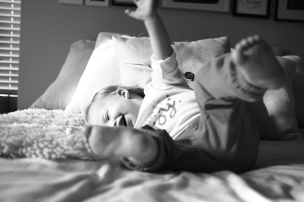 happy kid on bed picture by rebecca siewert