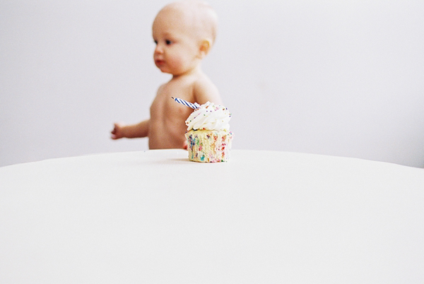 toddler with birthday cupcake photo by Meghan Boyer