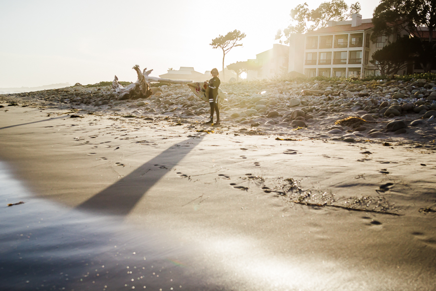 golden surfer on beach pic by kelly sweda
