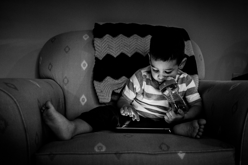 boy playing on ipad photograph by Jen Davis