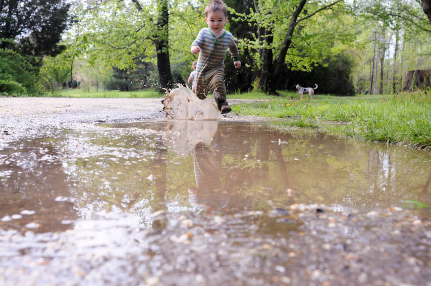 boy running through mud puddle photo by Chelsea McCown