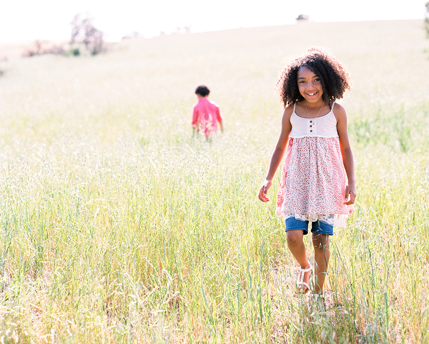 child in field photo by san francisco bay area photographer kim tsui