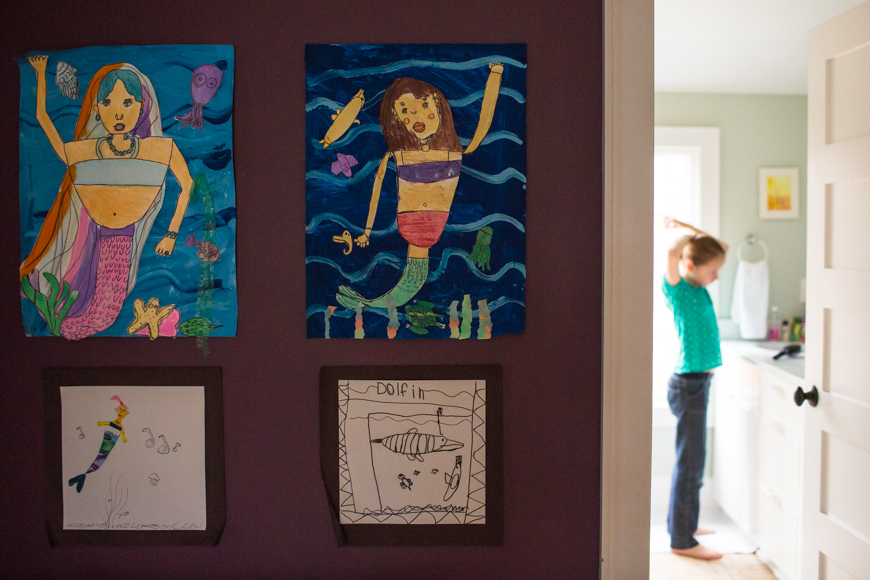 childrens artwork hanging on wall photograph by Aimee McNamee