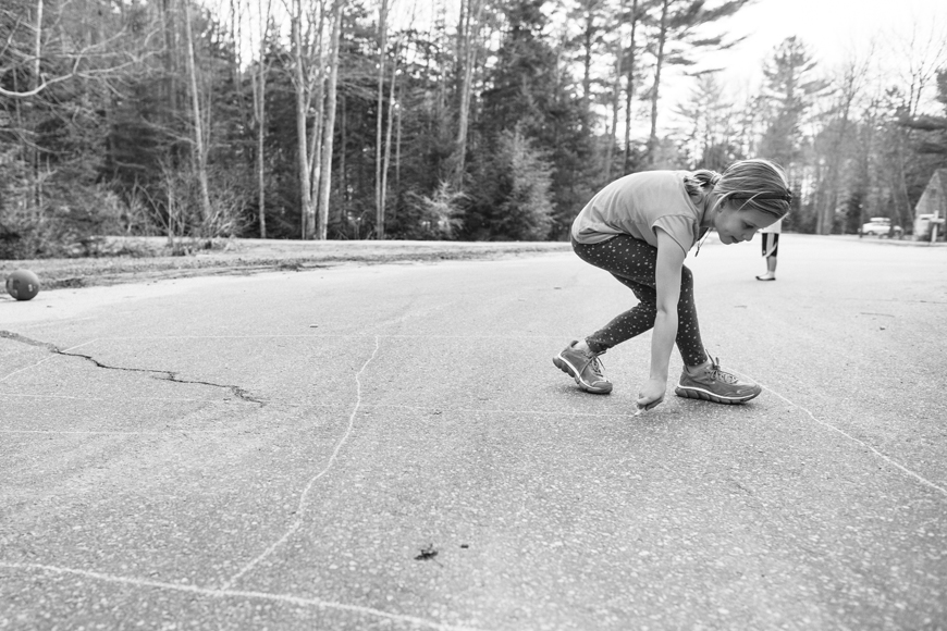 girl drawing four square on street photo by Becca Wood