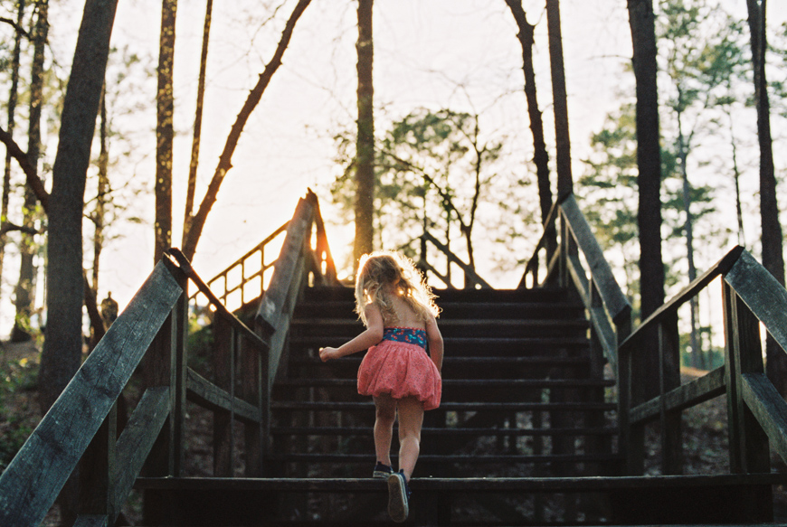 kid running up stairs pic by little bud photography