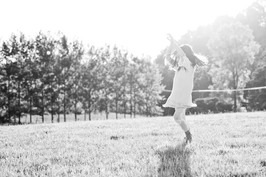 kid twirling outside pic by New Zealand photographer Sam Mothersole