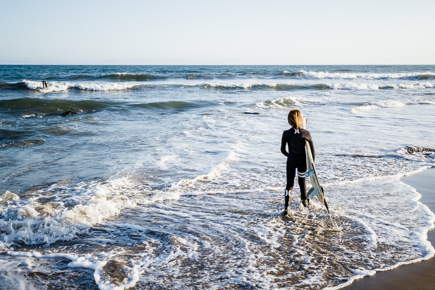 surfer boy in Pacific ocean pic by California photographer kelly sweda