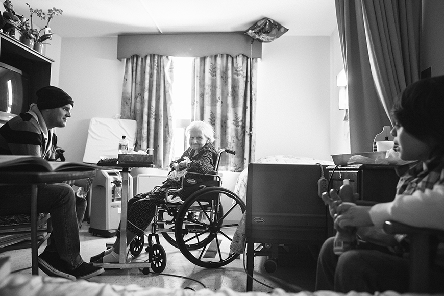 woman in wheelchair with family photograph by Jenneffer Vazquez