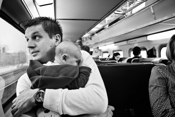 aneta kuros' black and white image of dad with baby on subway