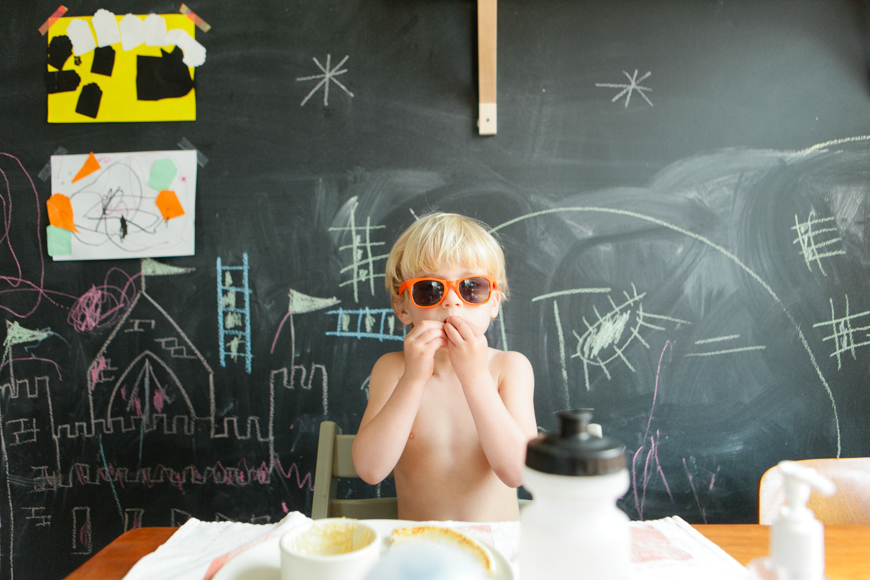 amily photographer brooke schwab's photo in front of chalkboard with sunglasses