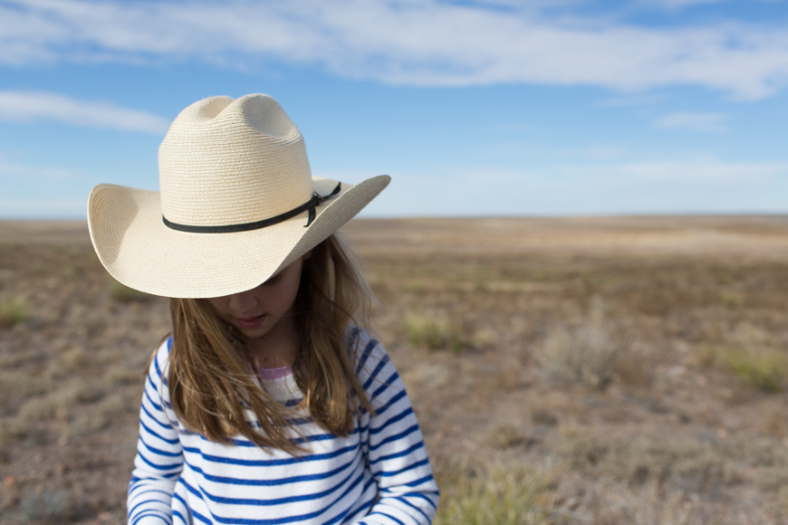 family photographer brooke schwab's photo of girl in cowboy hat