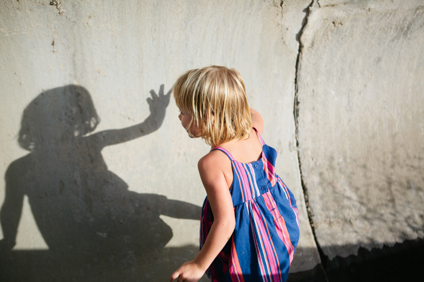 family photographer brooke schwab's photo of girl with shadow