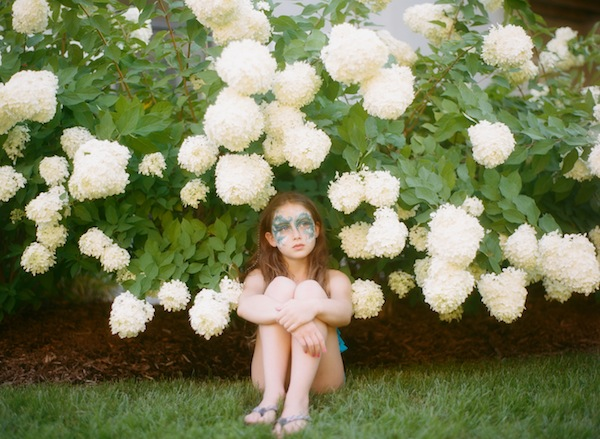 amy grace's photo of her daughter in the flowering bush