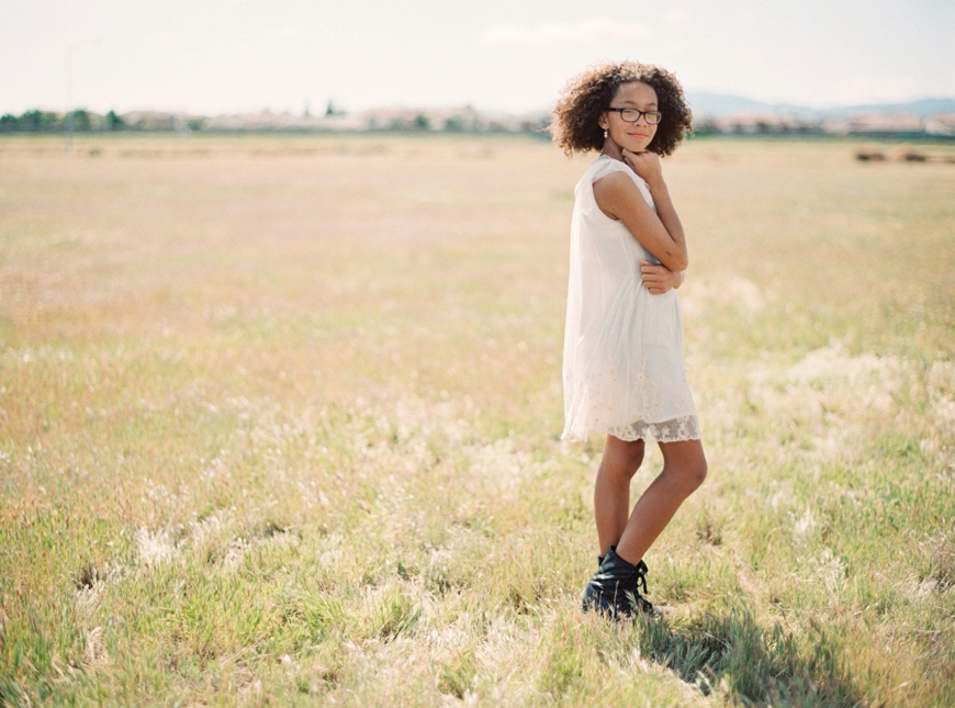 karyn johnson photography's image of girl in white in field