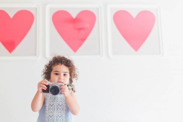 kelly musgrave's photo of girl with camera with three pink hearts