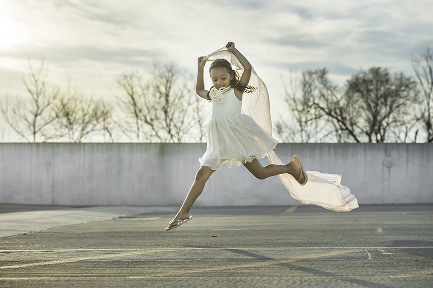 leah oconnell's image of girl in white jumping