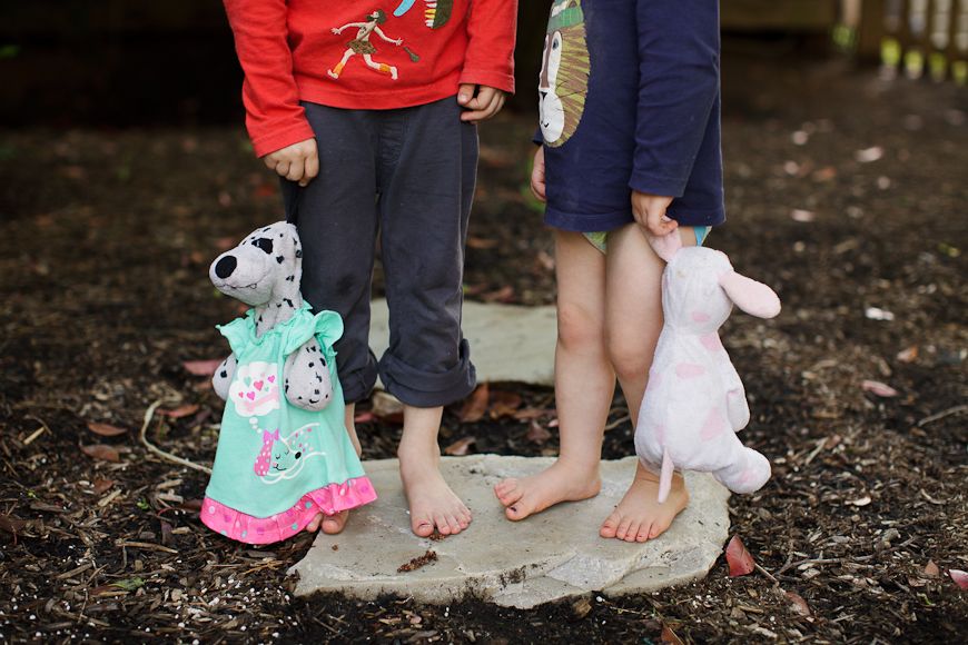 photo of girls feet and stuffed animals by Crystal Hardin