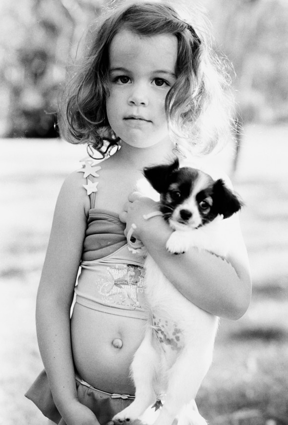 photographer toni raper's black and and whie image of puppy and girl