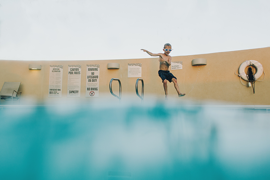 summer murdock's image of kid at pool taken from water