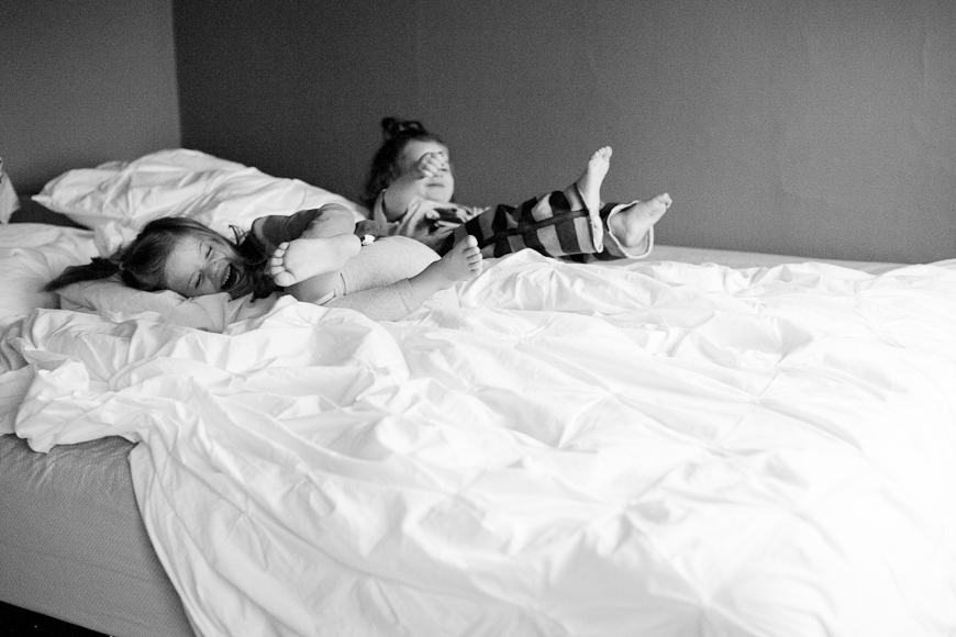 these two sisters photo project by crystal hardin in bed black and white