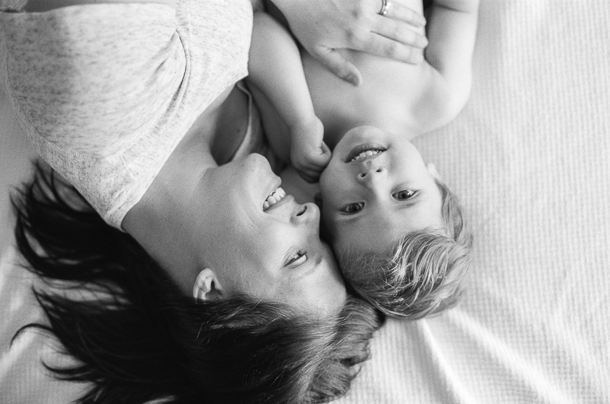 black and white image of mom and boy
