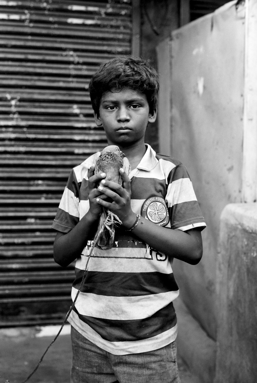 elise hanna's black and white image of boy with bird