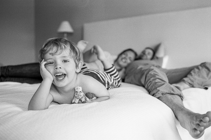 little boy laughing on bed picture by Carrie Geddie