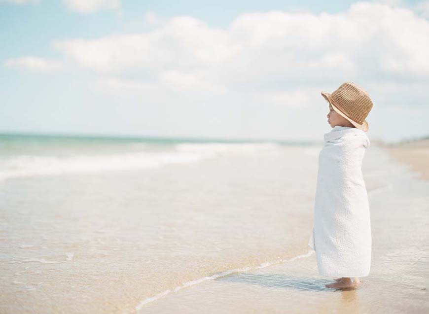 rebecca lindon's image of boy in hat looking at ocean