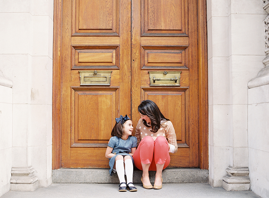 victoria phipp's photo of mom and daughter laughing in doorway