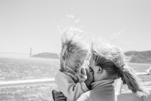 kelly sweda's black and white image of mom and daughter at beach