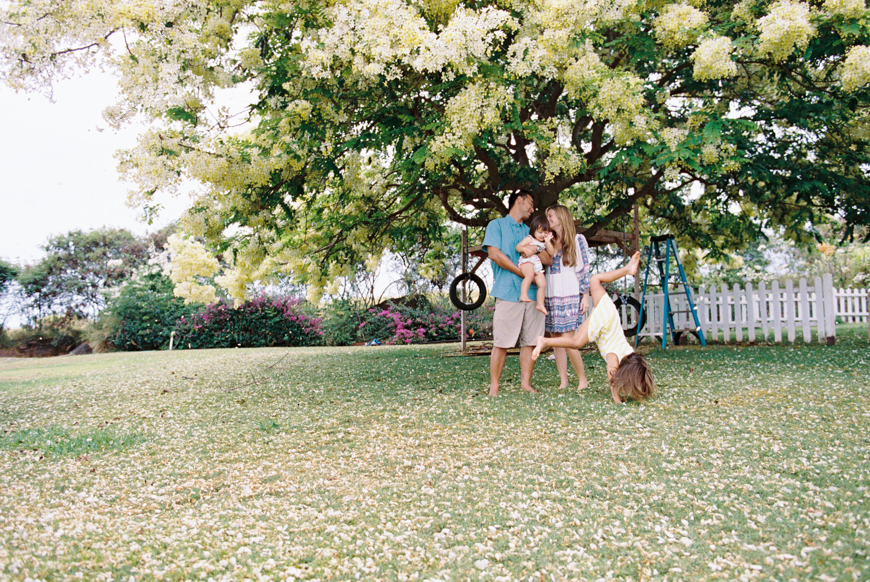 girl doing cartwheel in front of family by wendy laurel