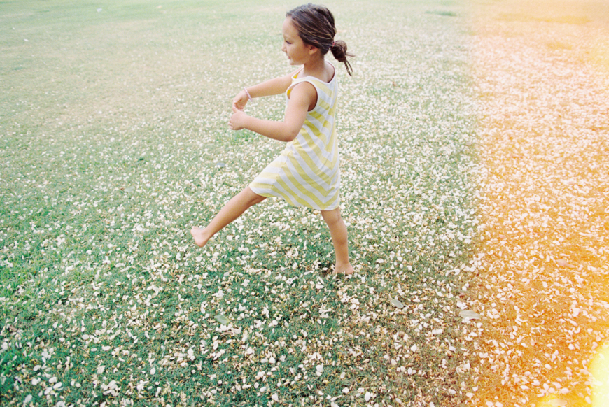 maui photographer wendy laurel's photo of girl in yellow and white striped dress with light leak