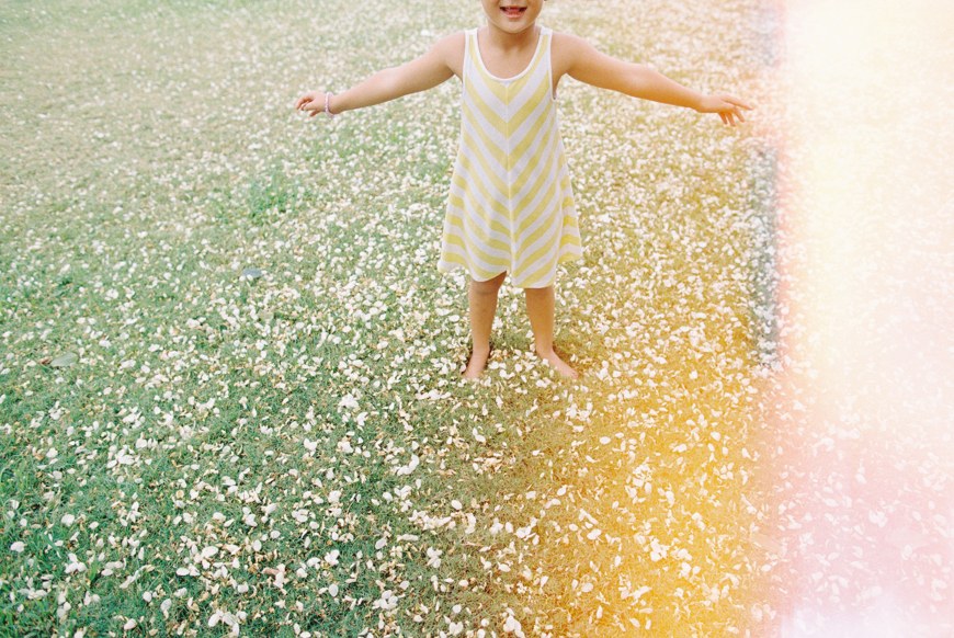 hawaii photographer wendy laurel's light leak photo of girl in flowers