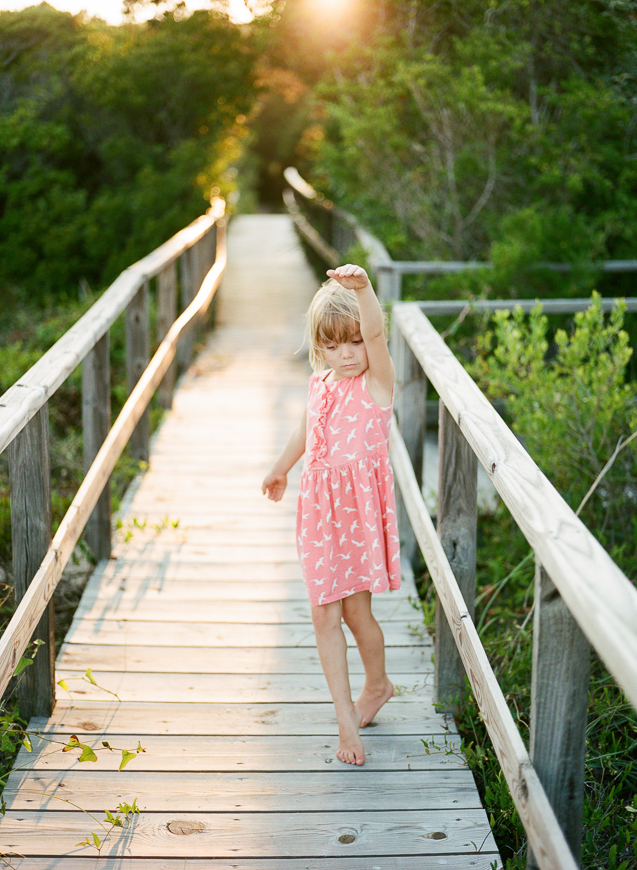 natalieseeboth's image of girl on wooden walkway with sunset