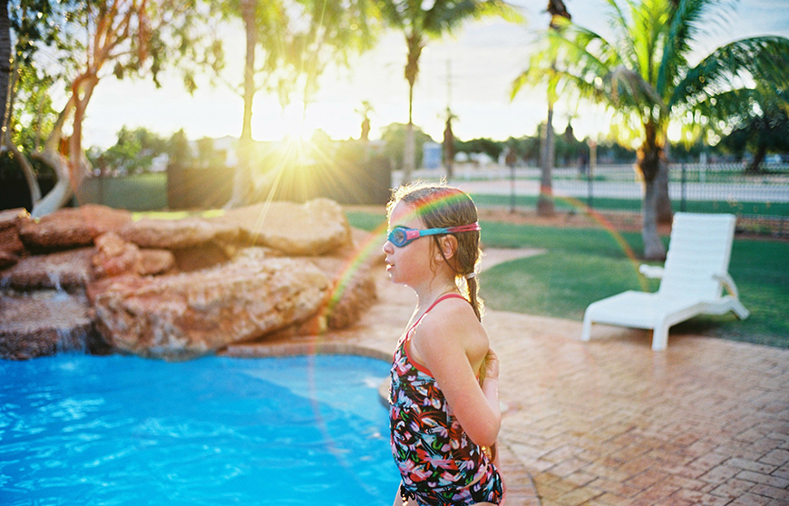 sarah black's pic of girl at pool with rainbow flare
