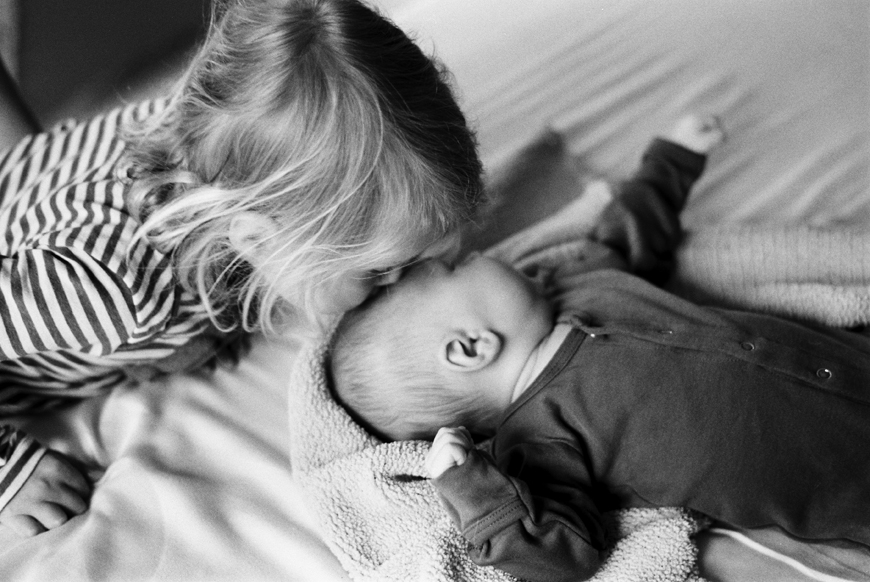 utah photographer heather howard's image of sister kissing baby brother