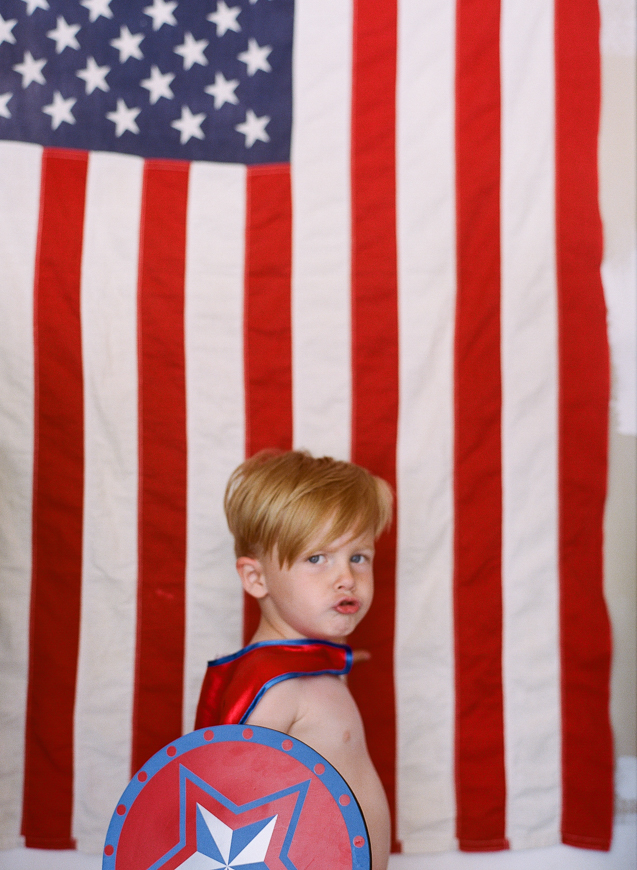 carolee beckham's photo of boy in front of amerian flag