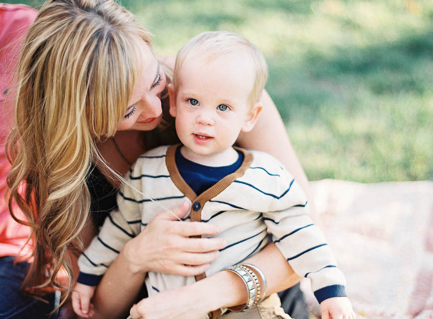mom holding toddler photo outdoors by Southern California photographer Lizzie Metcalf of S'Wonderful Photography