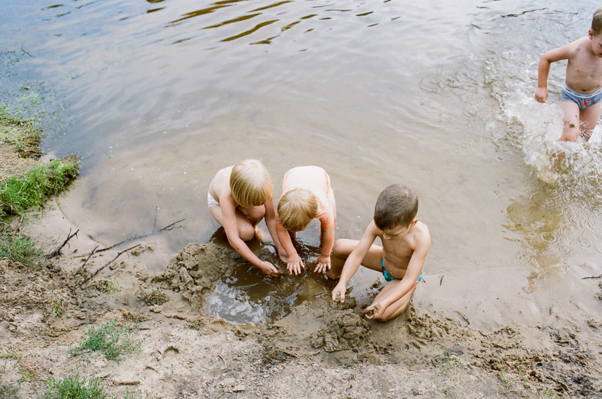 monika photography's film image of kids in river playing