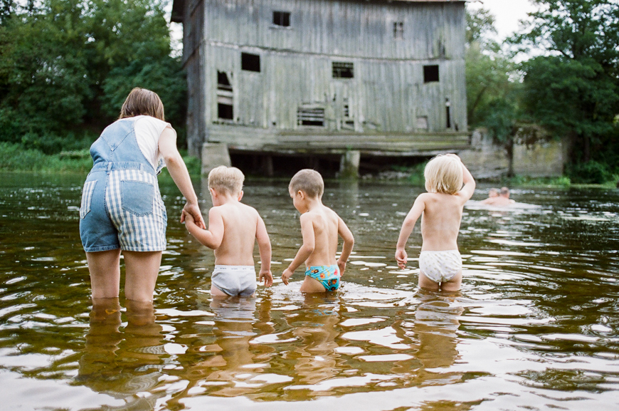 monika photography's film image of kids in river
