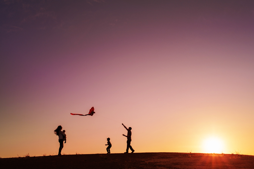 photos by kime's pic of family flying kite at sunset