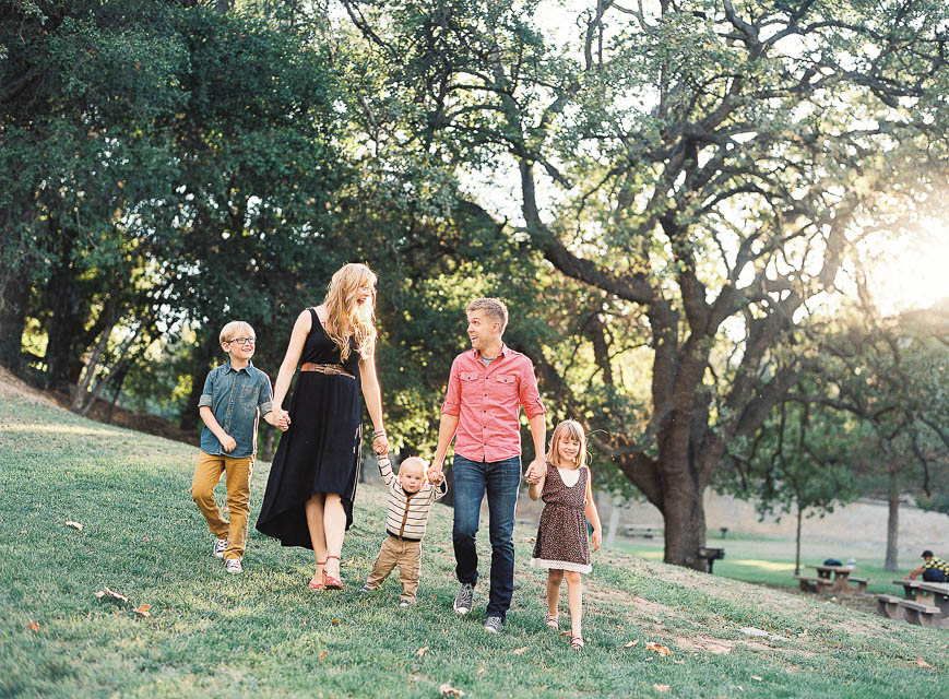 picture of family of five holding hands and walking by Los Angeles photographer Lizzie Metcalf of S'Wonderful Photography