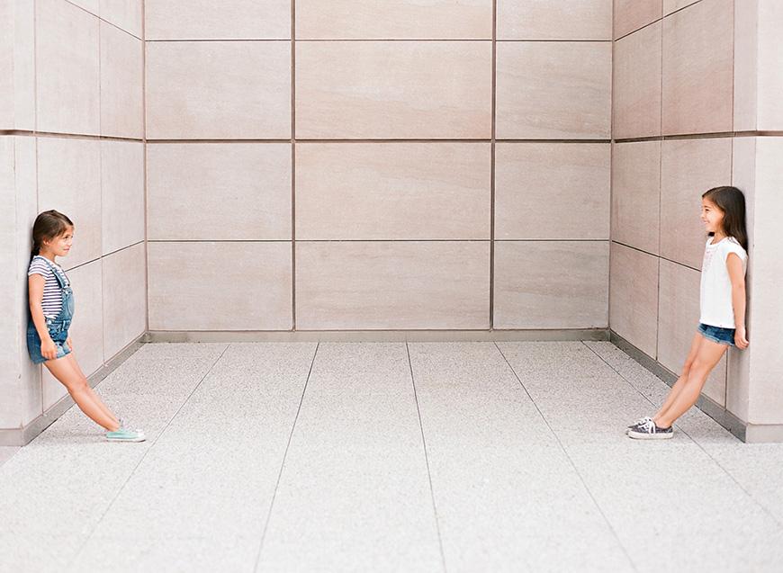 rebecca conway's photo of two girls against wall negative space
