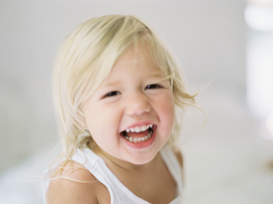 sweet child portrait in white room by photographer mara wolff