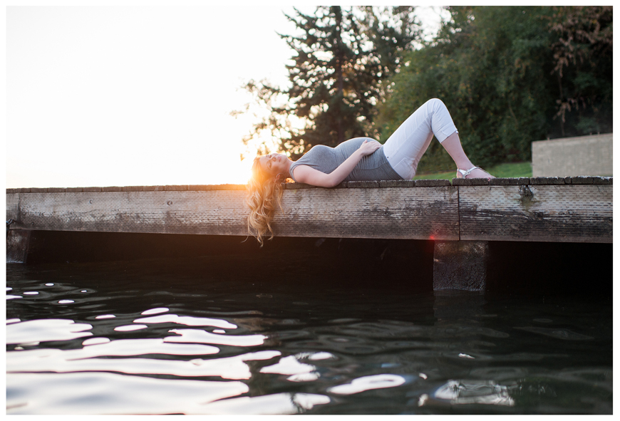 Blue Rose Photography's gorgeous light filled shot of pregnant girl laying on dock