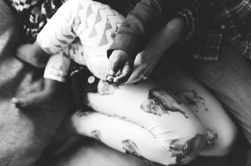 Catherine Abegg's black and white photo of family cuddling in pjs